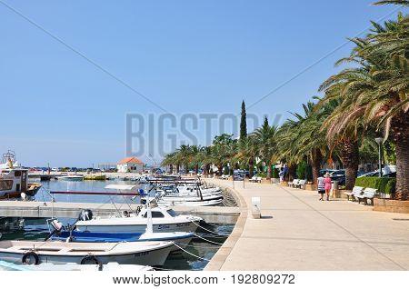 Baska Voda Croatia - August 22 2015: Baska Voda Marina marine harbor with nautical yachts and palms