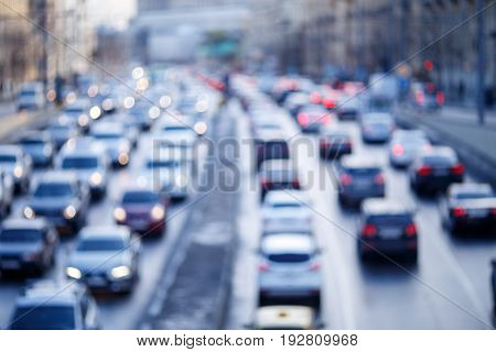 Blurred photo of city roads with moving cars in morning