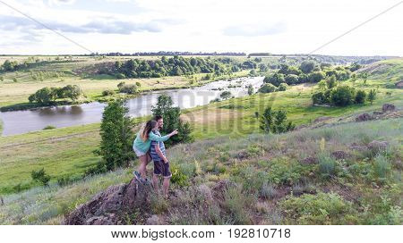 Young Couple On The Nature Of The View From The Top