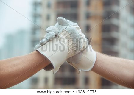 Male work building construction engineering occupation handshake