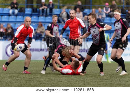 ST. PETERSBURG, RUSSIA - MAY 27, 2017: Match Busly, Belarus (red and white shirts) vs Livonia, Latvia during Rugby Europe Sevens Club Champion's Trophy