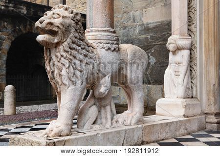 BERGAMO, ITALY - JANUARY 2, 2013: Detail of one of the lions supporting the columns of the right transept porch of the basilica of Santa Maria Maggiore. The porch was built in XIV-XV centuries