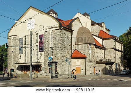 TALLINN, ESTONIA - JUNE 10, 2017: People at the building of Estonian Drama Theater. The Nordic Art Nouveau building is the oldest theatre in Estonia (1910) that has been preserved in its original form