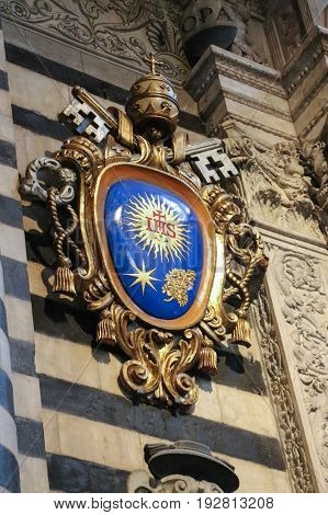Italy Siena - December 26 2016: the view of the Pope Francis coat of Arms at the entrance of the Duomo di Siena on December 26 2016 in Siena Tuscany Italy.