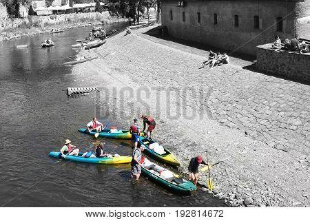 Cesky Krumlov Czech republic - July 9 2015: Canoeists with boats in Cesky Krumlov