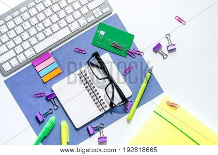 Money for education concept. Credit card, notebook, glasses and keyboard on wooden table top view.