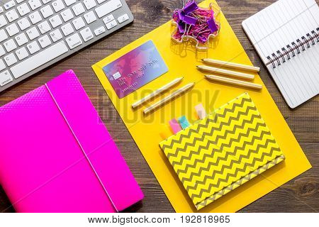 Money for education concept. Credit card, notebook and keyboard on wooden table top view.