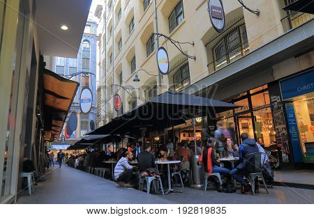 MELBOURNE AUSTRALIA - JUNE 14, 2017:  Unidentified people dine at narrow lane cafe in downtown Melbourne.
