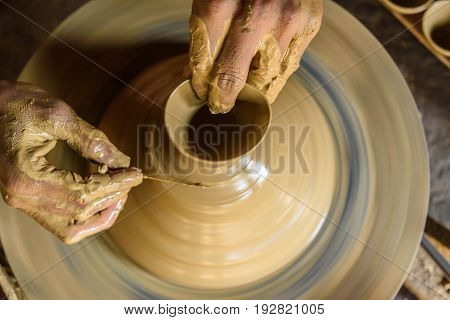 creative hands making clay pot for living purpose.