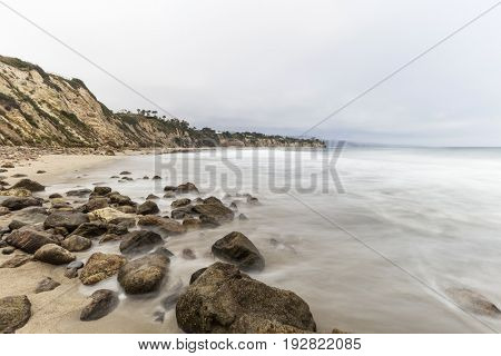 Dume Cove beach with motion blur water in Malibu, California.