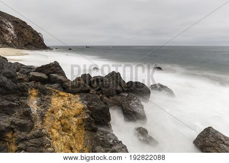 Motion blur water at Pirates Cove below Point Dume in Malibu, California.