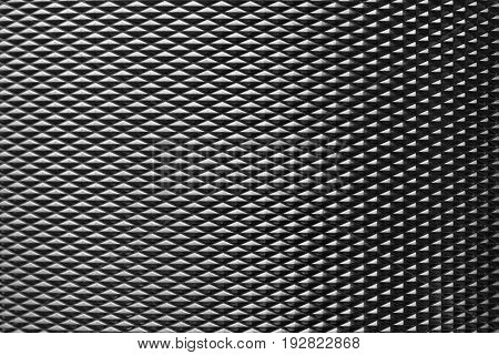 The diamond shape metal brush texture background in the dark scene. Metal texture background