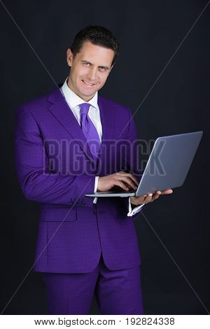 Happy Man Smiling With Laptop Or Computer