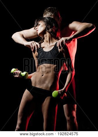 Woman And Sexy Man With Dumbbell