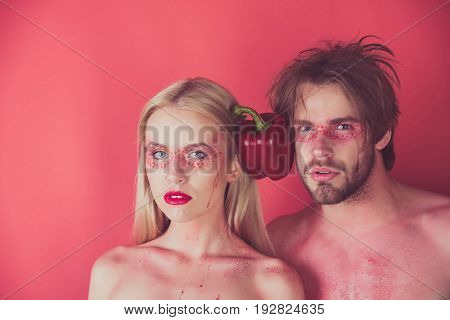 Woman And Man With Makeup Hold Pepper