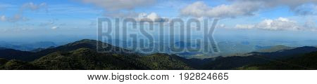 mountain range tropical rainforest canopy at southern of Thailand with more cloud. panorama scene