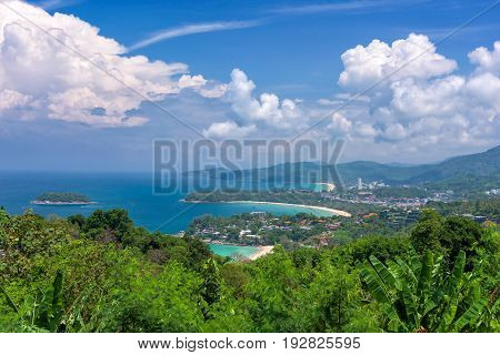 Tropical beach landscape with beautiful turquoise ocean waives and sandy coastline from high view point. Kata and Karon beaches Phuket Thailand