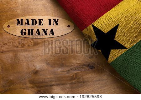 Stamp Made in Ghana poster with the national flag of Ghana.