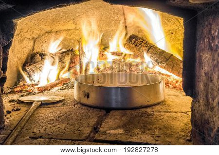 Delicious Food In Oven With Firewood