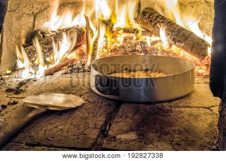 Delicious Pizza In Oven With Firewood