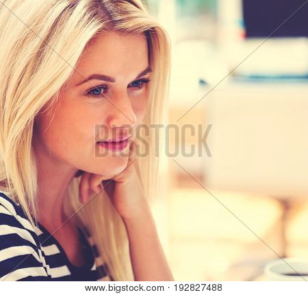 Young woman sitting at her desk in an office