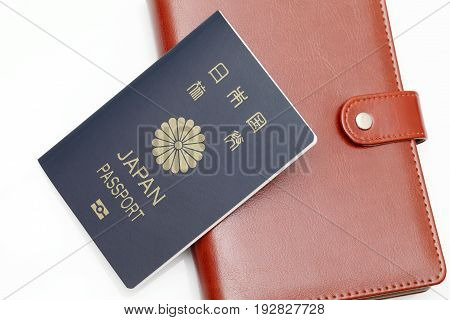 japan passport and leather notebook isolated on white background
