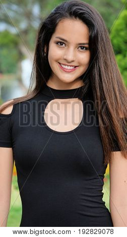Hispanic Teenage Girl And Beauty Wearing a Black Dress
