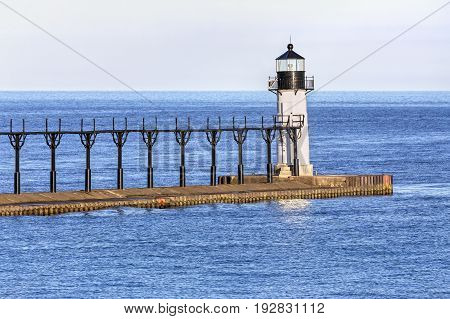The St. Joseph North Pier Outer Lighthouse marks the entrance to the town's harbor on Lake Michigan.