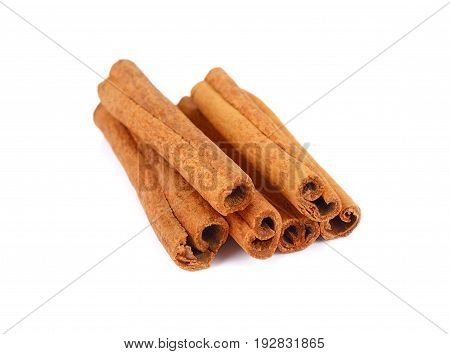 Fragrant cinnamon sticks isolated on white background Brown dry cinnamon sticks isolated
