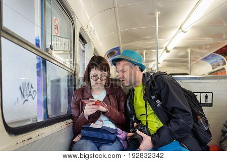 BARCELONA, SPAIN - MAY 2017: Tourists are sitting in funicular train to Tibidabo mount.