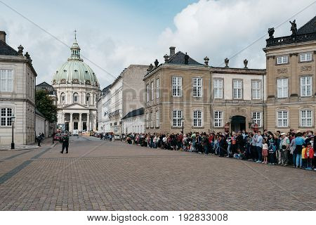 Copenhagen Denmark - August 12 2016:A crowd of tourists in waiting the changing guard in Amalienborg in Copenhagen. It is the home of the Danish royal family.