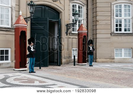 Copenhagen Denmark - August 12 2016: The guards of honour guarding the gates of the Royal residence Amalienborg Palace in Copenhagen.