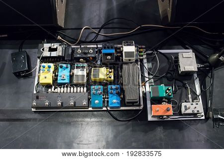 Electric guitar audio processing effect pedal on stage