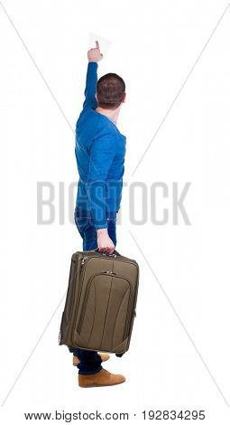 back view of  pointing man  with suitcase. brunette guy pointing .  backside view of person. Isolated over white background. guy with a travel bag on wheels looking at something at the top