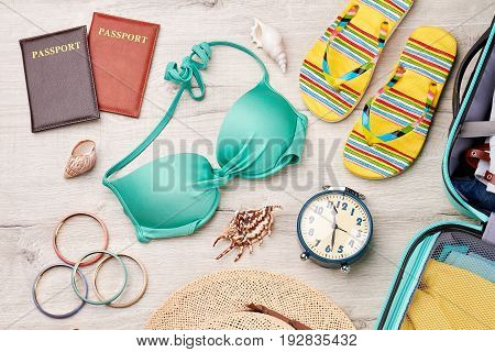 Time to departure to seaside. Traveler summer stuff for journey abroad.