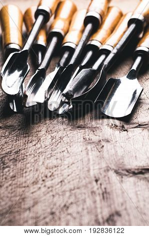 A Set Of Chisels On A Old Wooden Table