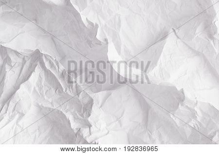 Crumpled relievo soft white paper texture. Abstract background.
