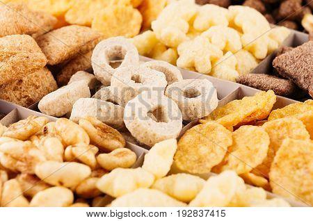 Corn flakes set closeup decorative chess pattern. Cereals background.