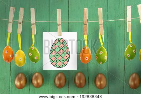 PE047_eggs_02_bs_nf against golden easter eggs arranged on wooden surface