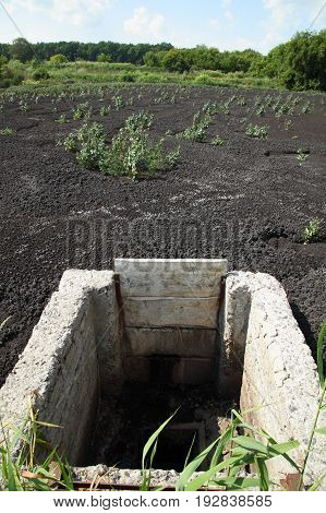 Drying feces into fertilizer. Lake for drying sewage.The drain in the industry.