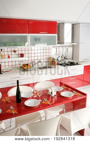 interior shot of clean modern red kitchen design