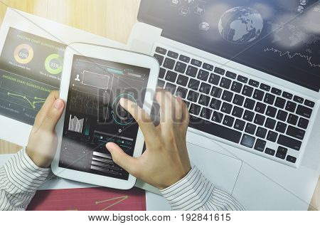 business hand point on tablet with Finance Trading Stock Graph Chart homepage on computer screen. invesment analysis concept.
