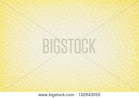Closeup surface of yellow leather of sofa texture background
