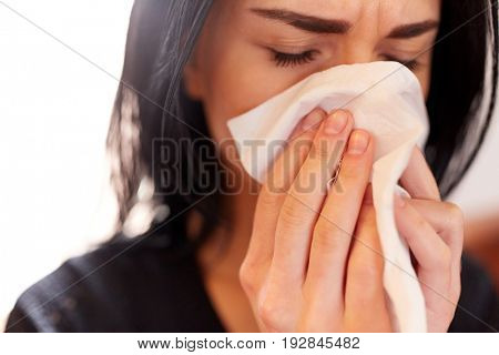 people, grief and mourning concept - close up of woman with wipe crying at funeral
