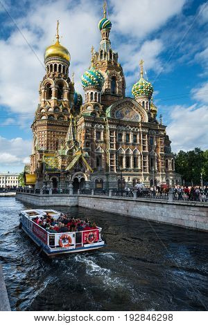 Walking Boat Moves Through The Channel Griboyedov On The Background Church Of The Savior On Blood