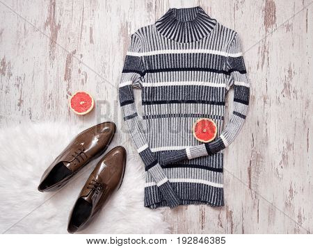 Striped Knitted Sweater, Brown Patent Leather Shoes, Halves Of Cut Grapefruit. Wooden Background. Fa