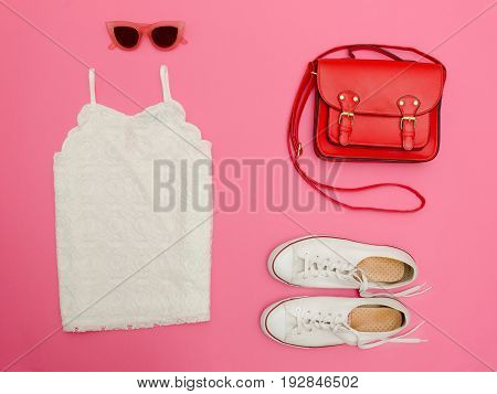 White Lace Top, Red Handbag, White Sneakers And Rose-colored Glasses. Bright Pink Background, Close-