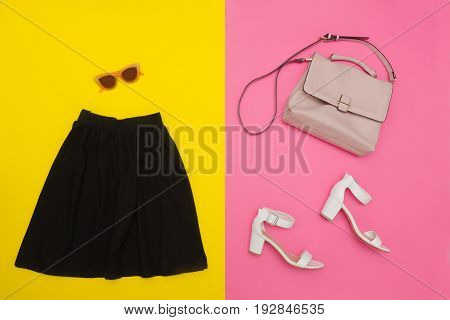 Black Skirt, Handbag, White Shoes And Rose-colored Glasses. Bright Pink-yellow Background. Fashionab