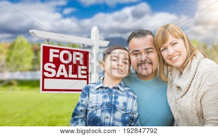 Mixed Race Family Portrait In Front of House and For Sale Real Estate Sign