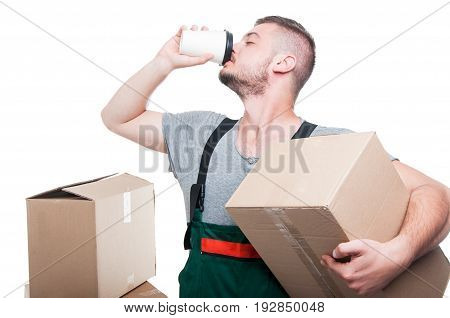 Mover Man Holding Cardboard Box And Drinking Coffee